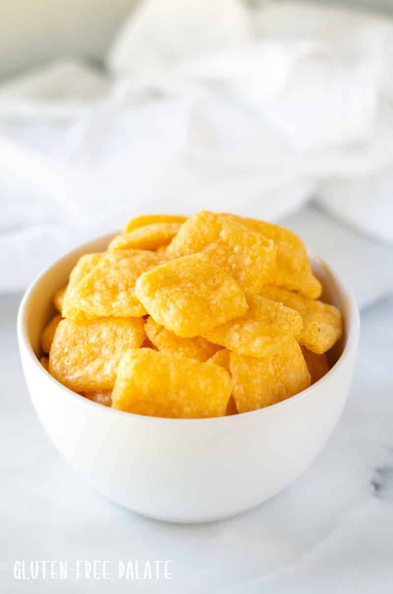 gluten free cheese crackers in a white bowl