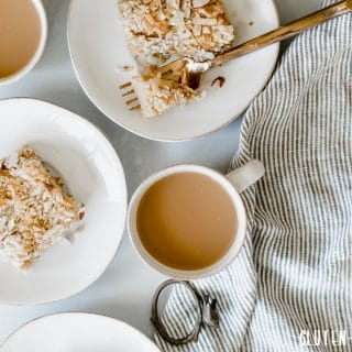 Gluten-Free Toasted Almond Coconut Crumb Cake next to a cup of coffee