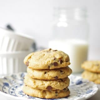 four stacked flour-less Gluten-Free Chocolate Chip Peanut Butter Cookies