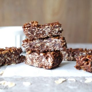 three chocolate coconut oat bars stacked