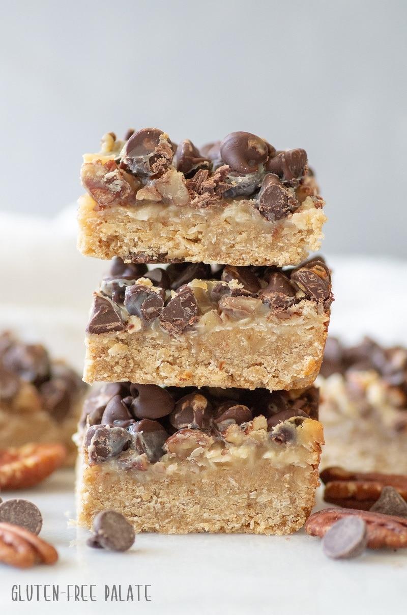 three gluten-free seven layer bars stacked