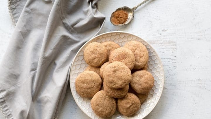a plate of gluten-free, dairy-free, grain-free snickerdoodles topped with cinnamon