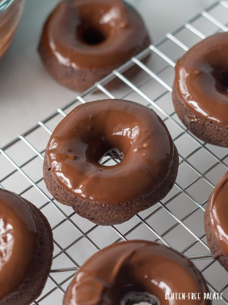 Gluten-Free Vegan Donuts with a chocolate glaze on a wire cooling rack