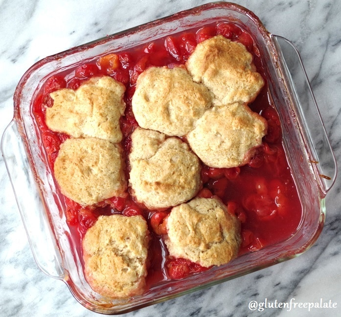 Gluten free cherry cobbler in a clear baking dish
