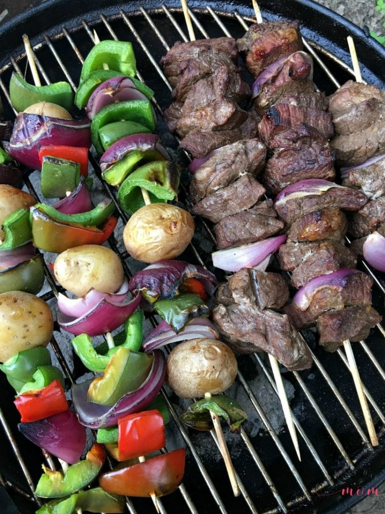 beef and vegetable kebabs on a grill
