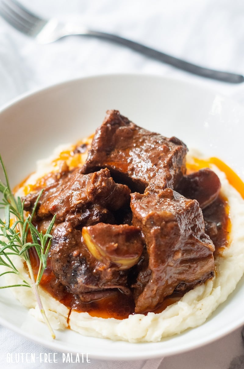 side view of beef short ribs over mashed potatoes
