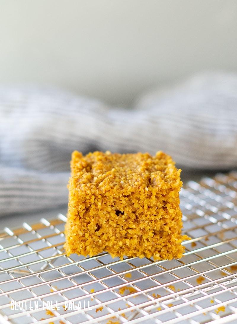 slice of pumpkin cornbread on a cooling rack
