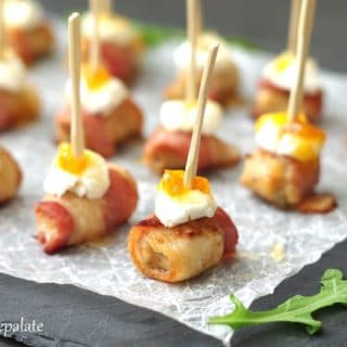 a close up of Sausage Appetizer with bacon and goat cheese with a toothpick in the center