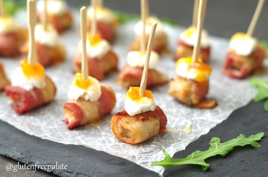 Sausage Appetizer with bacon and goat cheese with a toothpick in the center