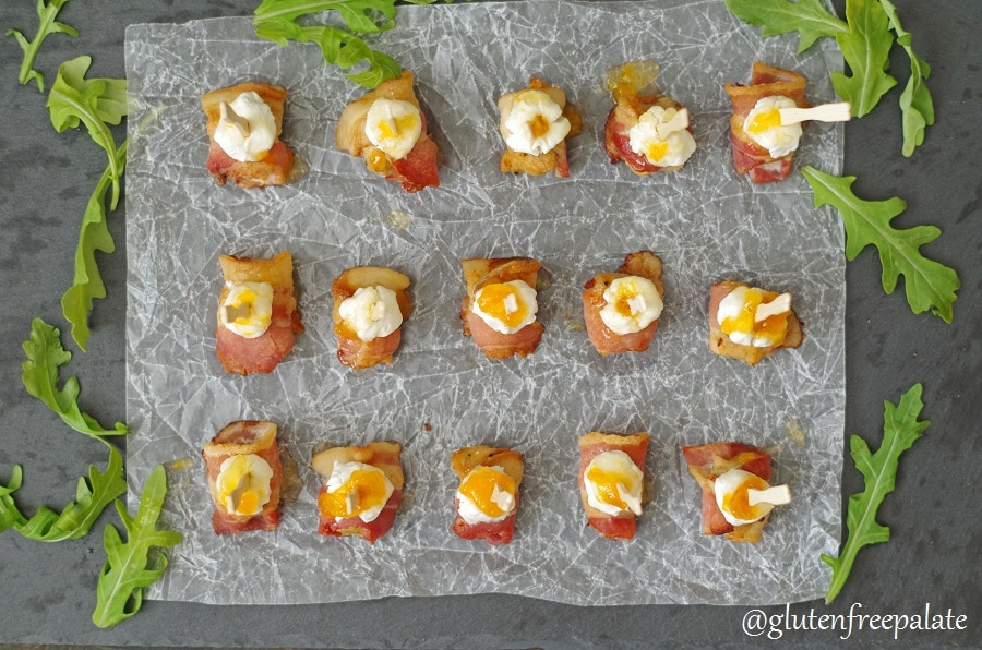 a top down view of Sausage Appetizer with bacon and goat cheese with a toothpick in the center