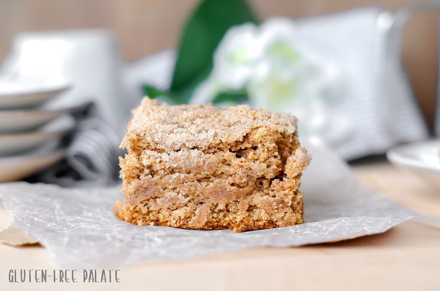 a slice of gluten free chai coffee cake on a piece of parchment paper