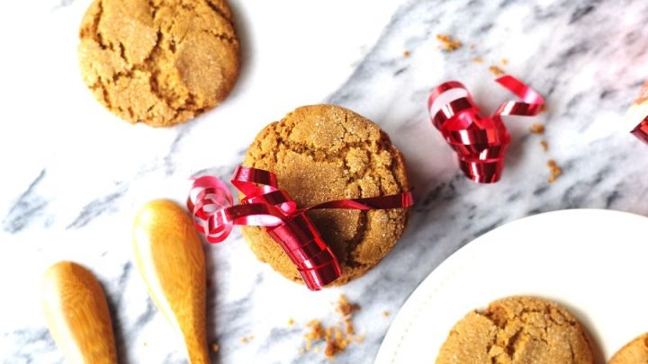 a close up of Gluten Free ginger snap cookies wrapped with a red ribbon for decaration