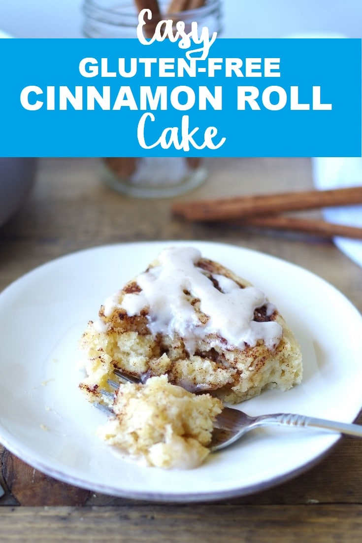 a pinterest pin with a photo of a side view of a slice of cinnamon roll cake on a white plate with a fork with the words easy gluten free cinnamon roll cake