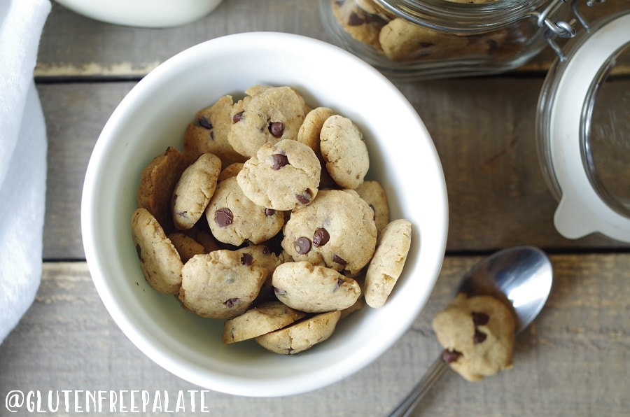 gluten free vegan cereal in the shape of chocolate chips cookies in a white bowl