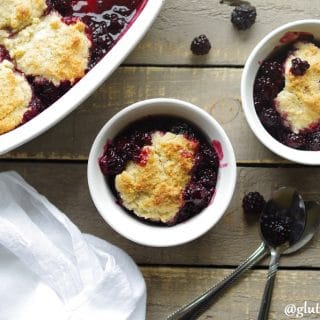 a close up of a Gluten-Free Blackberry Cobbler in a white baking dish