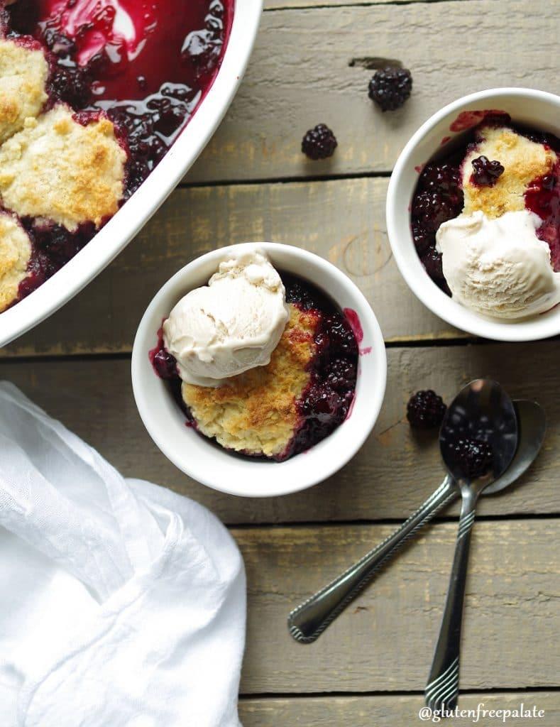 Gluten-Free Blackberry Cobbler in a white baking dish with vanilla ice cream