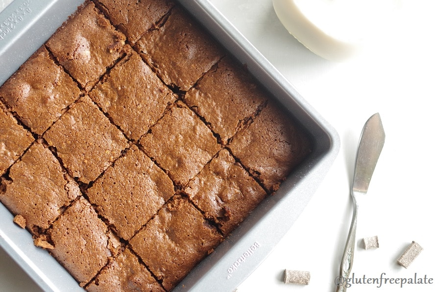 top down view of brownies in a pan next to a butter knife