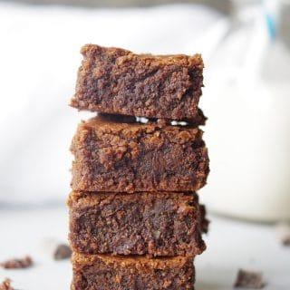 a close up of four brownies stacked