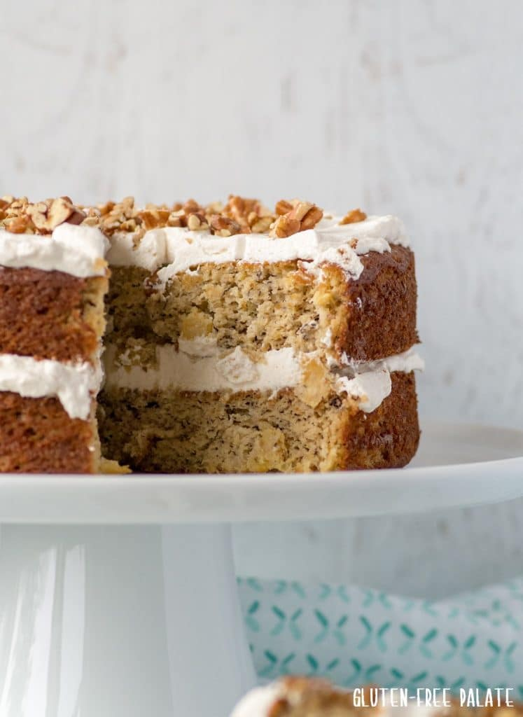 a side view of a double layer hummingbird cake with a slice out showing the inside texture