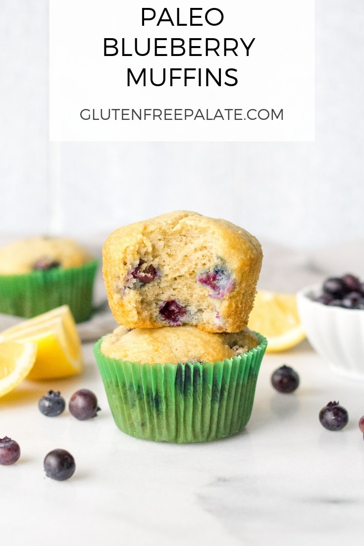 a pinterest pin with two muffins stacked, the top muffin has a bite out showing the blueberries on the inside, with the words paleo blueberry muffins at the top