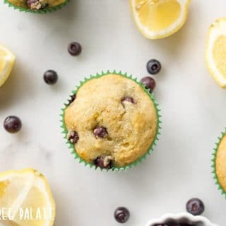 top down view of paleo blueberry muffins next to lemon wedges