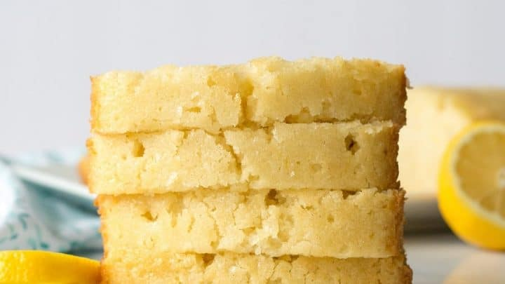 four stacked pieces of Gluten-Free Lemon Bread on marble