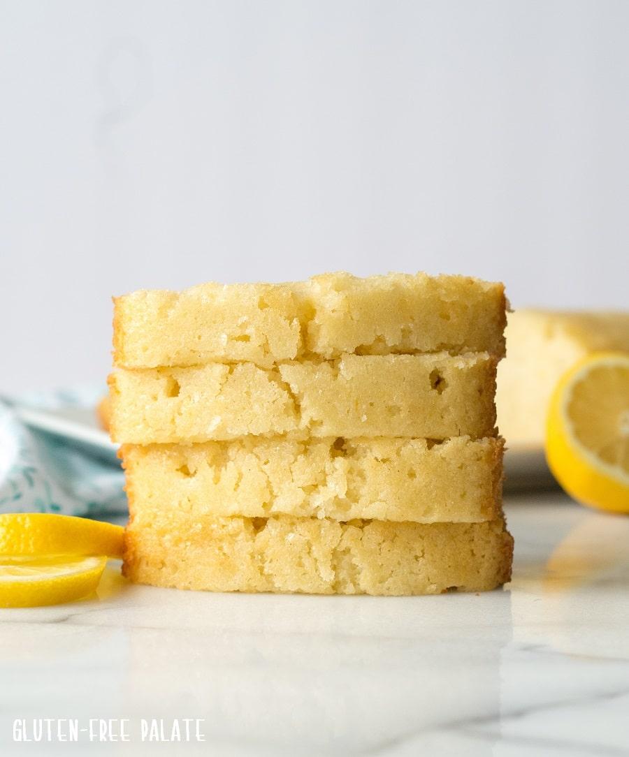 four slices of lemon bread next to lemon slices