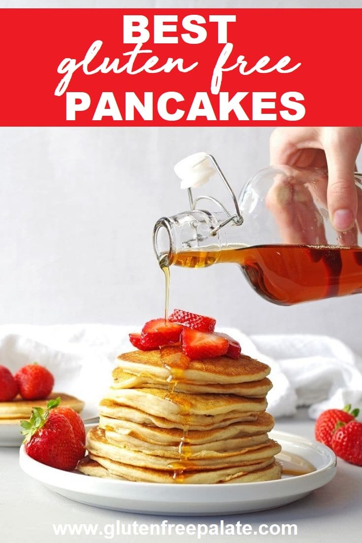 a pinterest pin image of pancakes stacked on a white plate with a hand pouring maple syrup on top