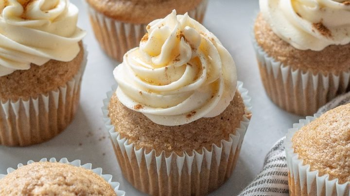 frosted Gluten-Free Chai Cupcakes on a striped grey napkin