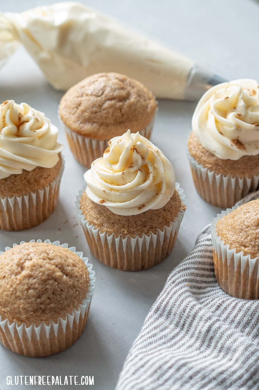 chai cupcakes with white frosting swirled on top