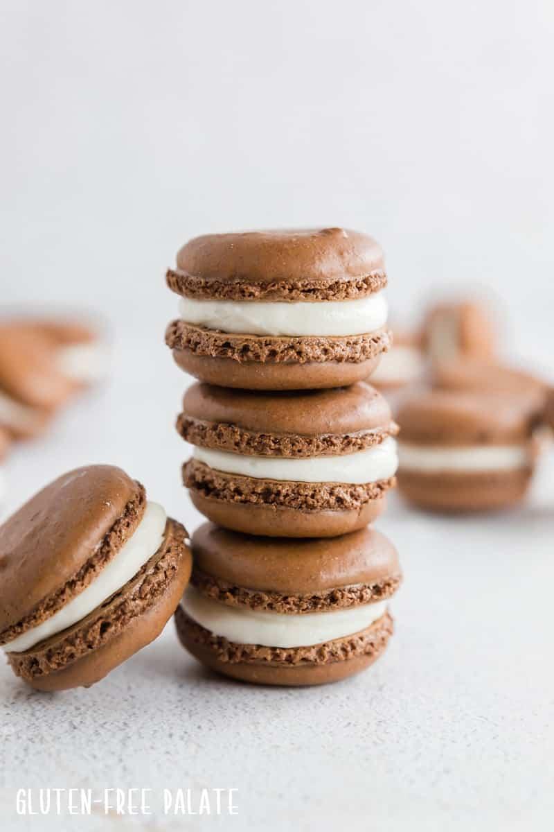 three gluten free chocolate macarons stacked