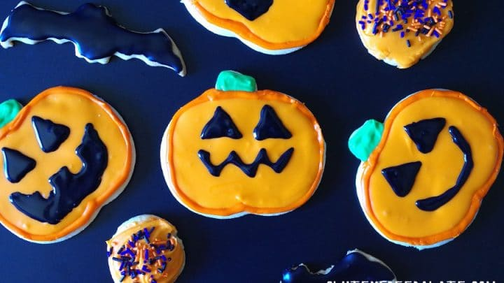 A close up of gluten free sugar cookies decorated like jack-o-lanterns
