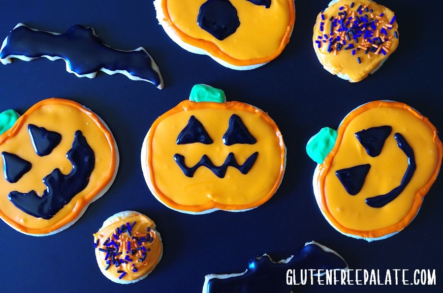 gluten-free sugar cookie pumpkins and bats decorated for Halloween