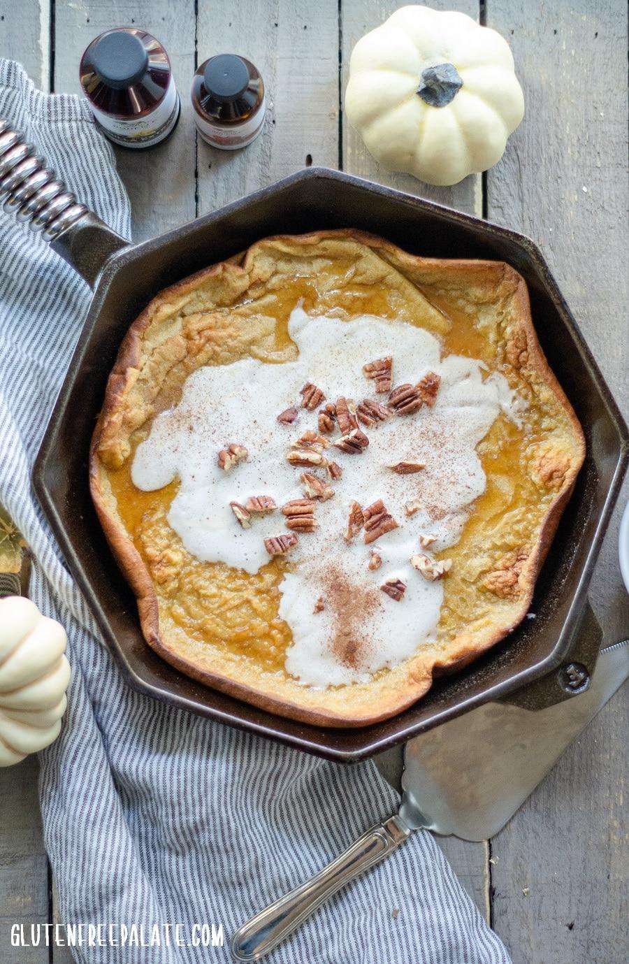Gluten free pumpkin spice dutch baby in a cast iron skillet.