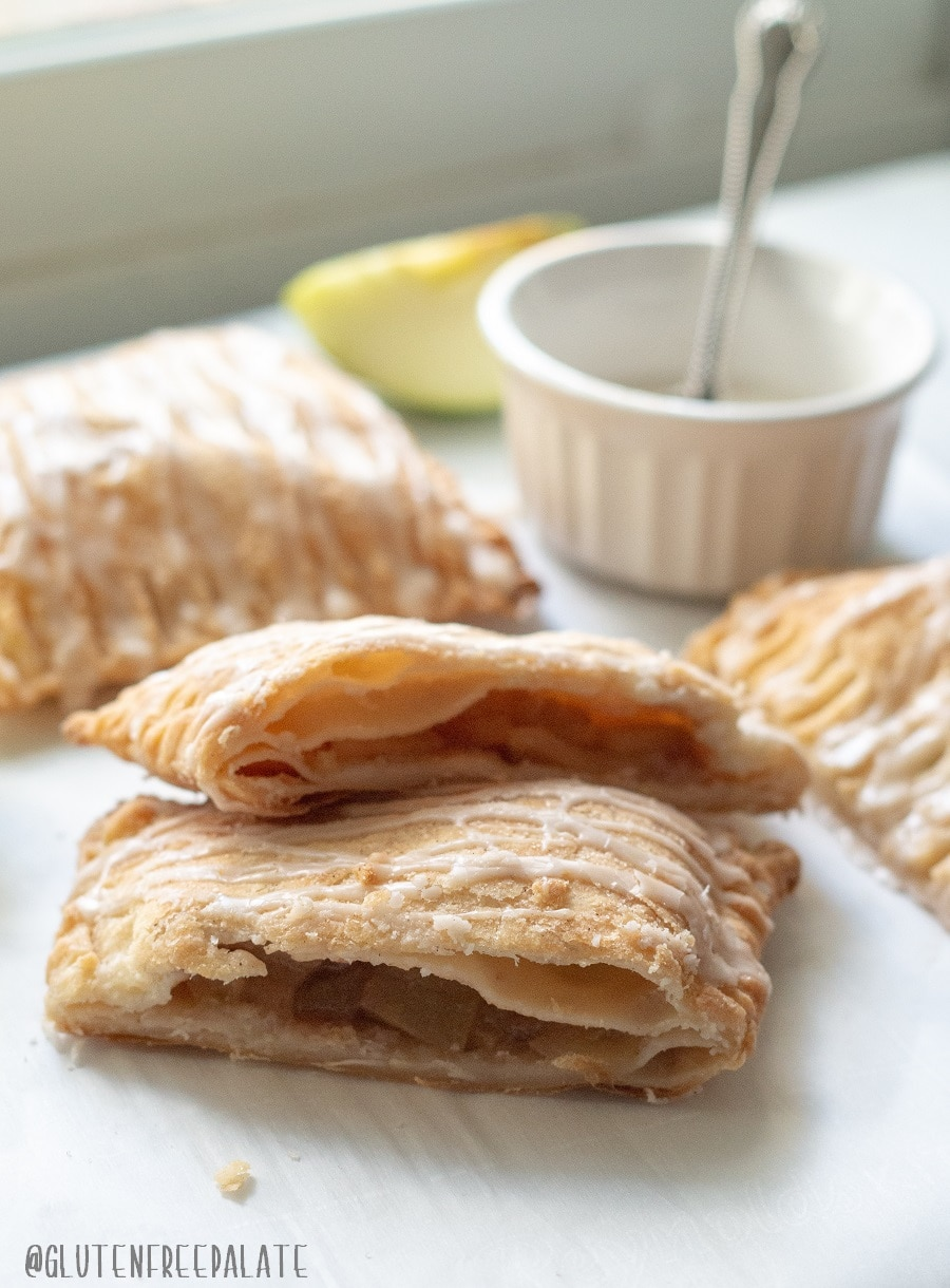 a side view of an apple turnover cut in half to show the apple filling