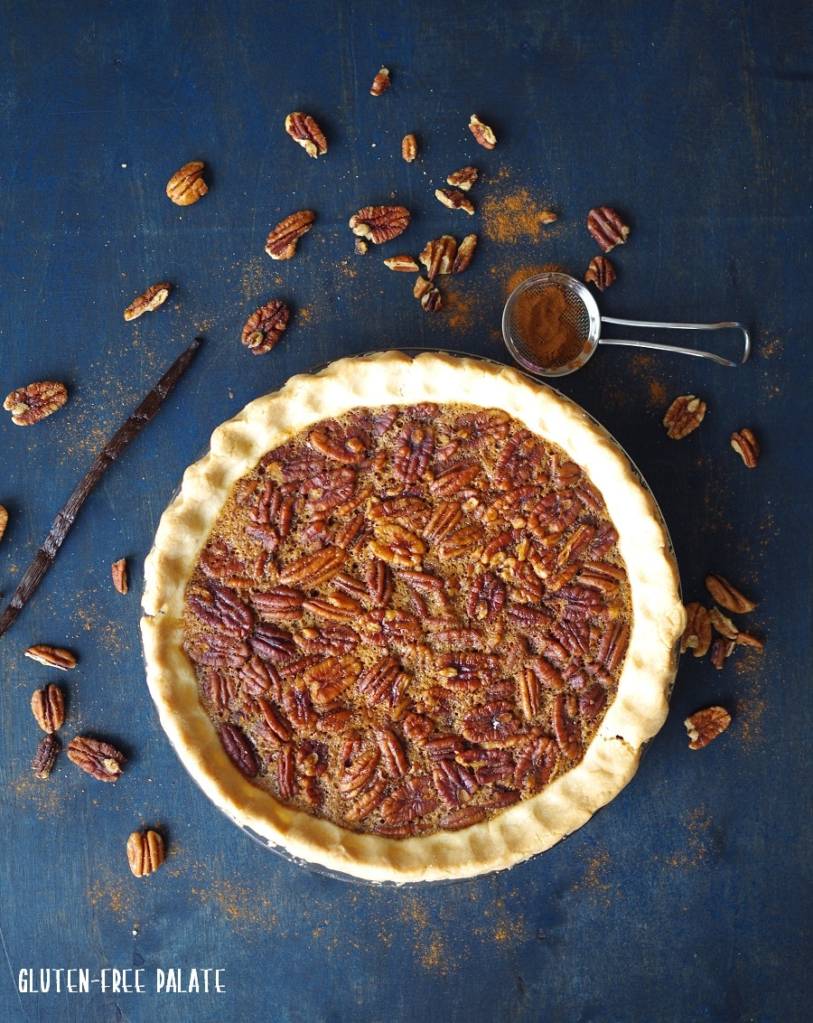 top down view of a pecan pie with scattered pecans