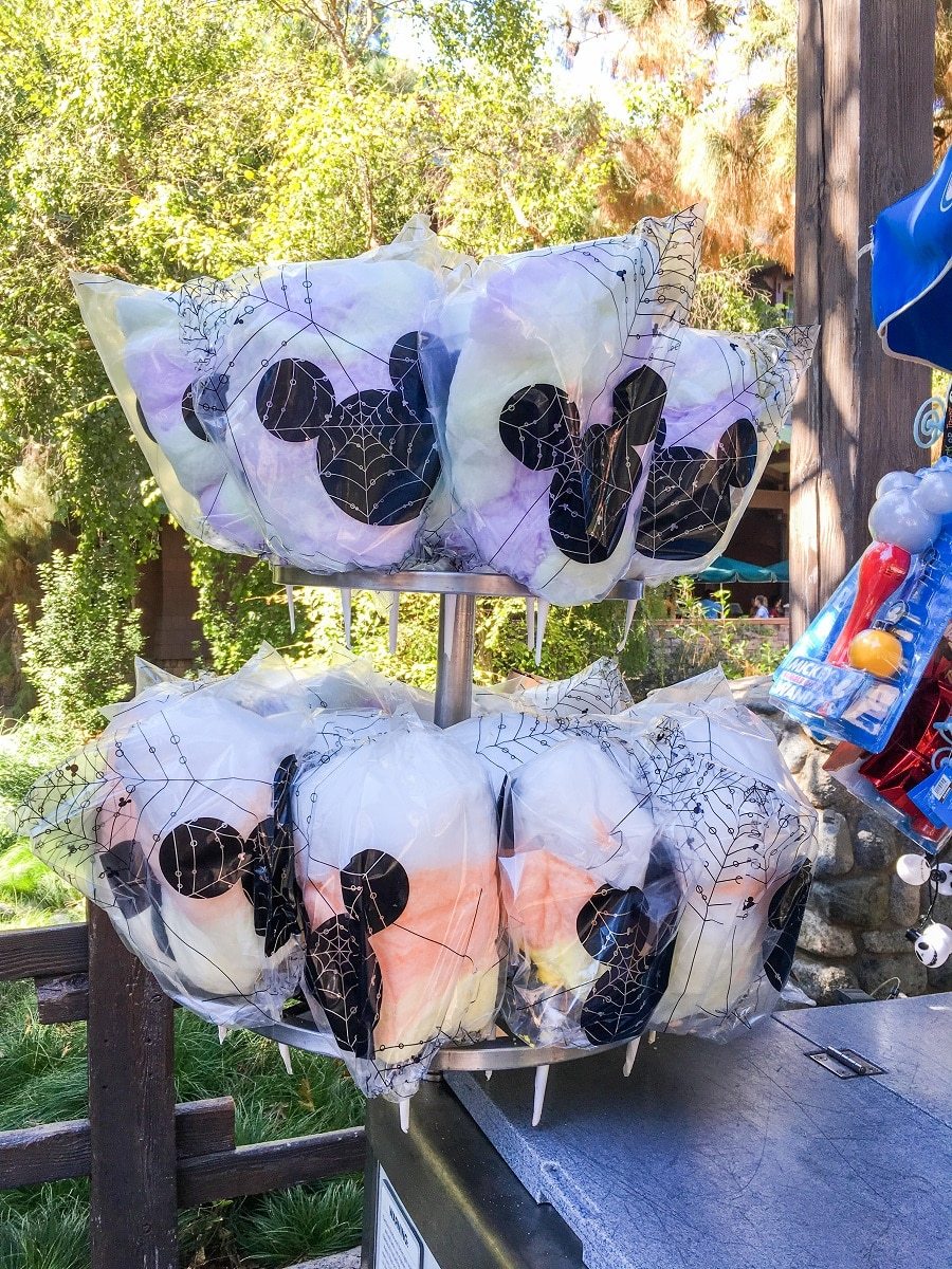 a tray of cotton candy with mickey ears printed on the packaging
