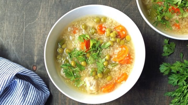 bowl of quinoa soup topped with cilantro