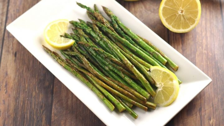 lemon wok asparagus on a white square plate