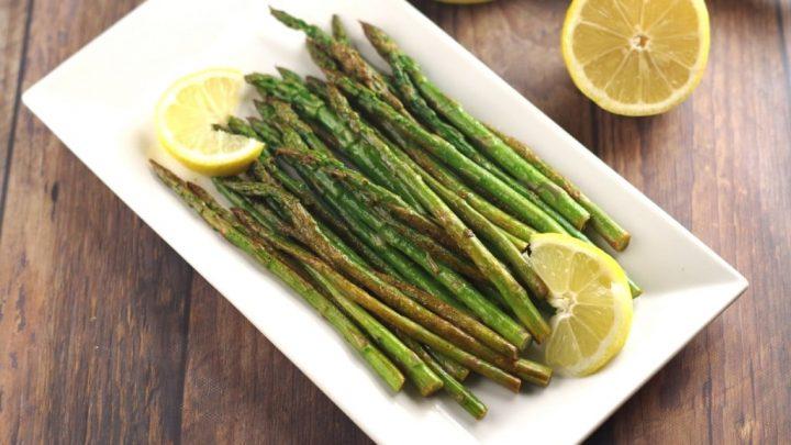 lemon wok asparagus on a white square plate