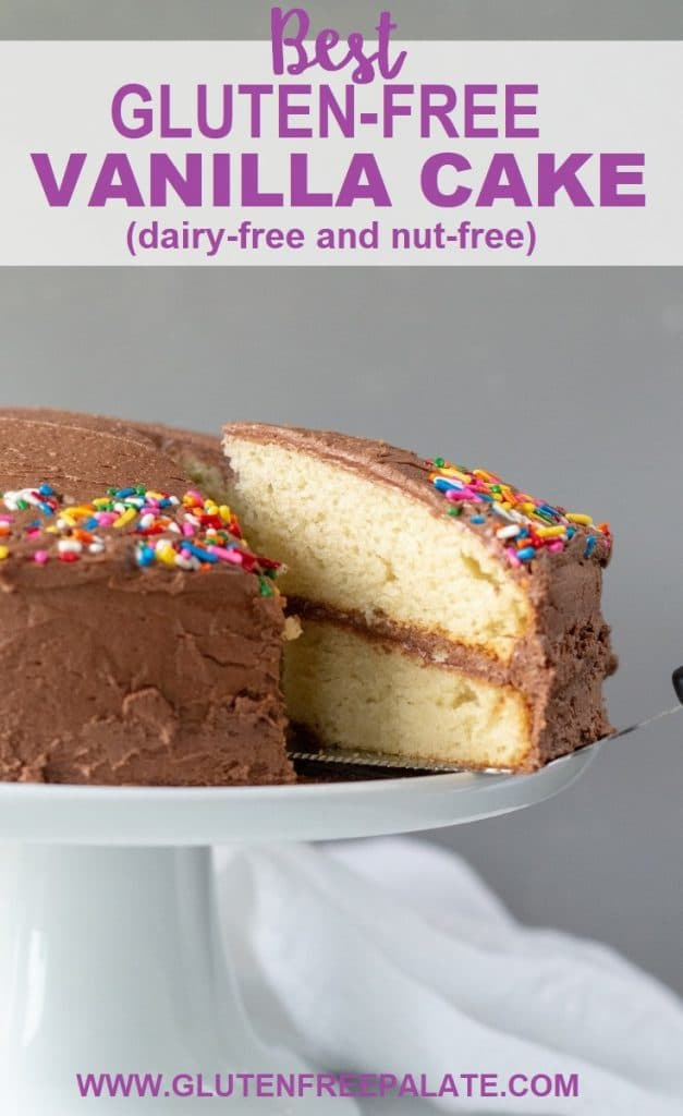 A slice of gluten-free vanilla cake with chocolate frosting being served from a cake plate, with the words best gluten free vanilla cake written at the top