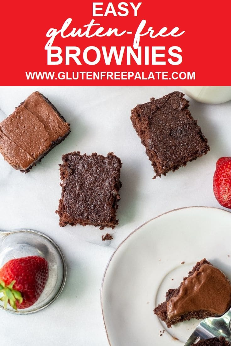 four brownies and two strawberries on a white marble slab with the words east gluten free brownies in text on top