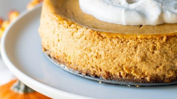 Gluten Free Pumpkin Cheesecake on a white cake platter