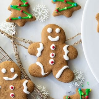 gluten free gingerbread men and tree cookies with white and green icing