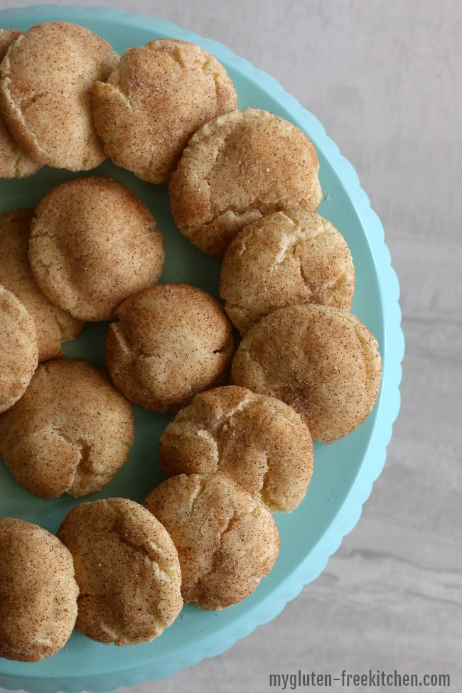 gluten free snickerdoodle cookies arranged on a blue plate