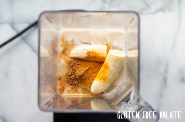 banana, milk, ice and turmeric in a blender jar