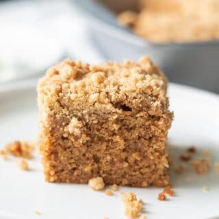 a slice of gluten free coffee cake on a white plate