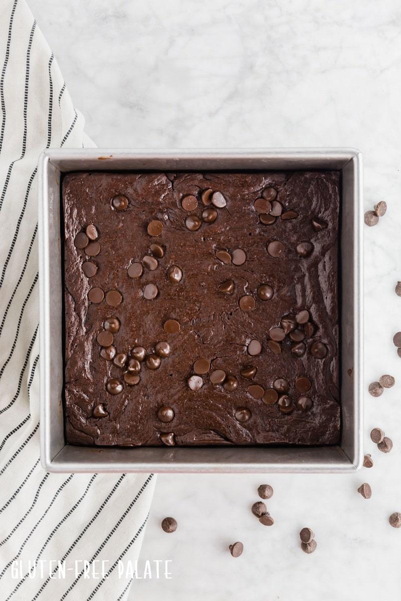 a metal panfilled with baked flourless brownies
