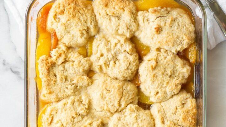 gluten free peach cobbler in a glass baking pan