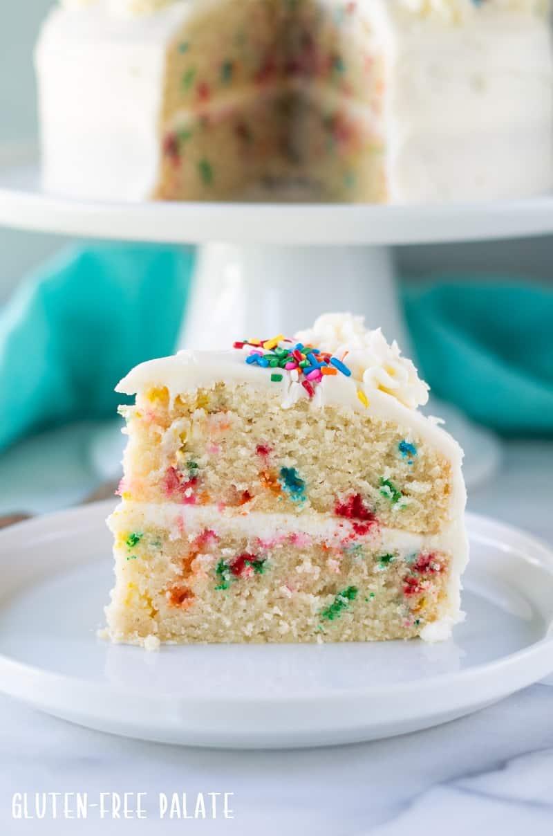 close up view of a slice of gluten free funfetti cake